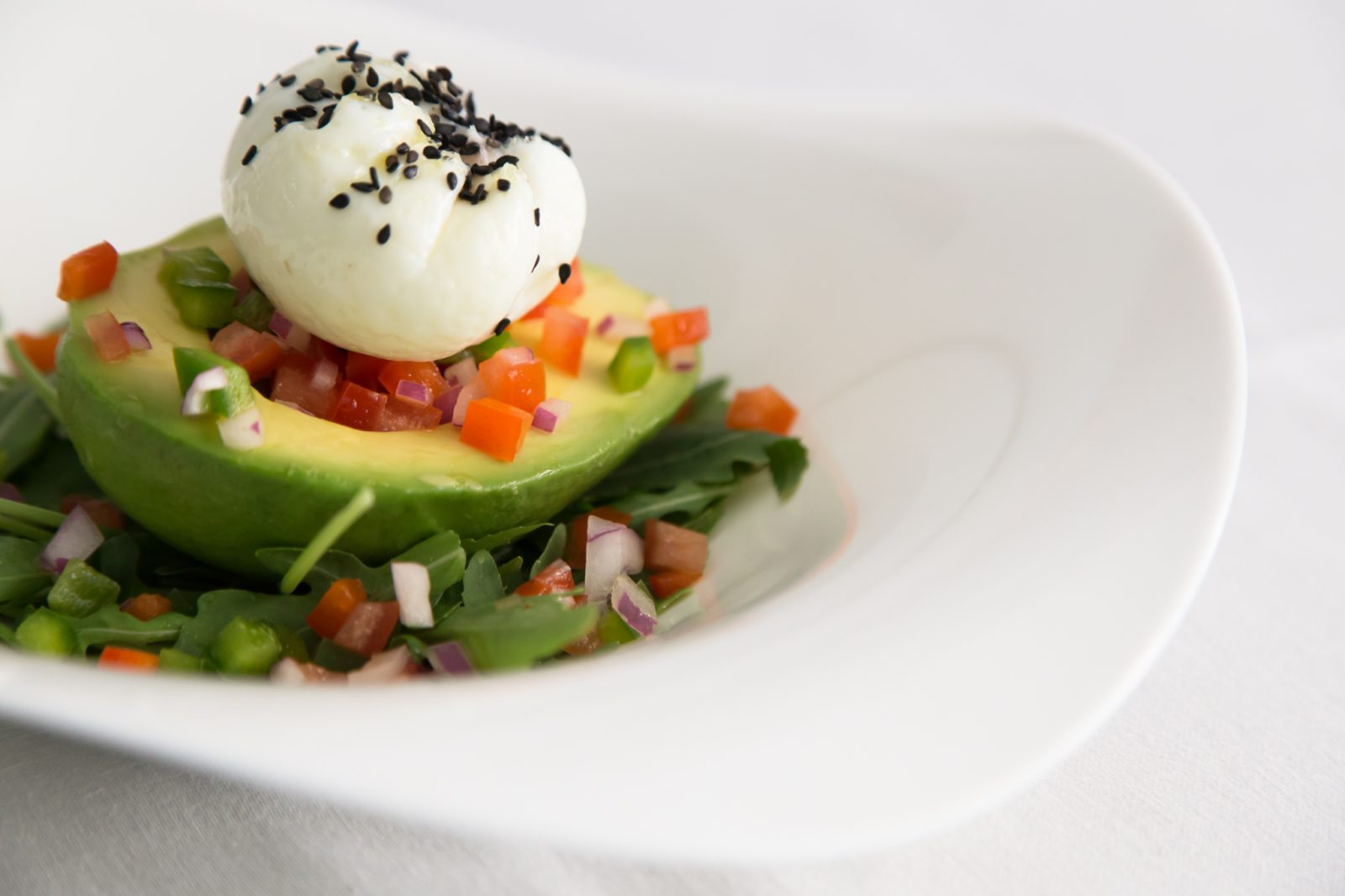 "Barcelona Bootcamp Recipe - Poached egg accompanied by half avocado, Mexican ""pico de gallo"""